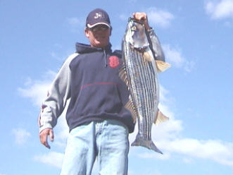 Guide, Billy Jack Miller, Jr. with a 30lb striper